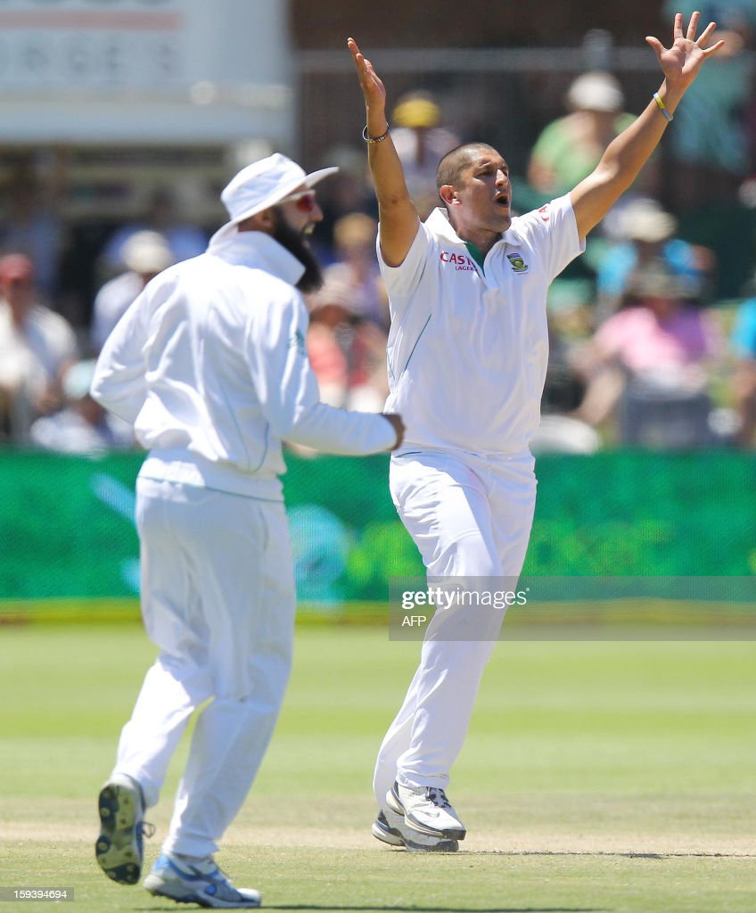 Rory Kleinveldt and Hashim Amla (L) of South Africa appeal for a leg before decision during the third day of the second and final Test between South Africa and New Zealand at the Axxess St George's Cricket Stadium on January 13, 2013 in Port Elizabeth. AFP Photo / Anesh Debiky