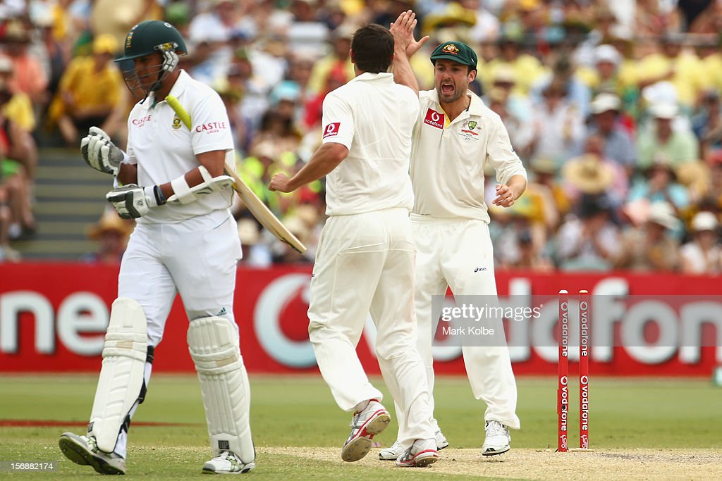 Rory Kleinveldt of South Africa leaves the field as Ben Hilfenhaus and Ed Cowan of Australia celebrate his wicket during day two of the Second Test match between Australia and South Africa at Adelaide Oval on November 23, 2012 in Adelaide, Australia.