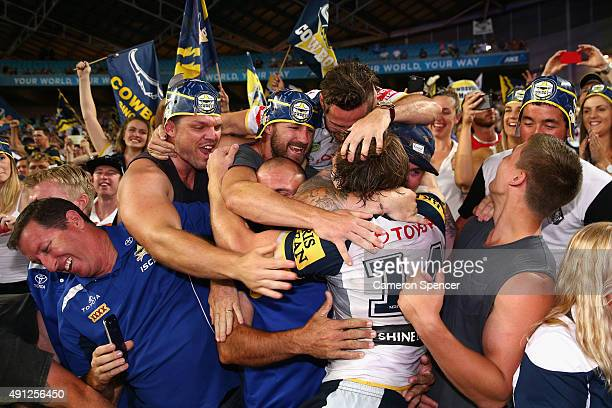 Rory Kostjasyn of the Cowboys celebrates with fans after winning the 2015 NRL Grand Final match between the Brisbane Broncos and the North Queensland...