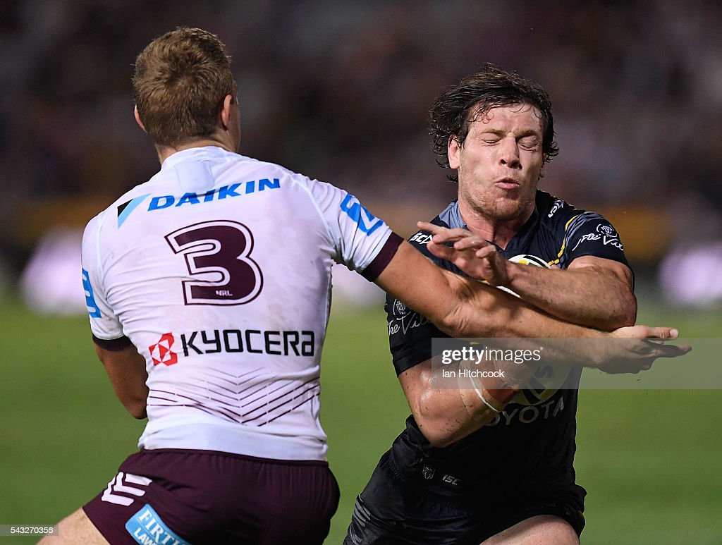 Rory Kostjasyn of the Cowboys is tackled by Tom Trbojevic of the Sea Eagles during the round 16 NRL match between the North Queensland Cowboys and the Manly Sea Eagles at 1300SMILES Stadium on June 27, 2016 in Townsville, Australia.