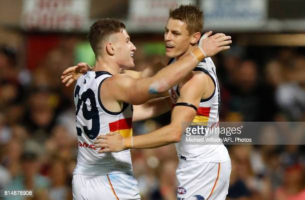 Rory Laird and David Mackay of the Crows celebrate during the 2017 AFL round 17 match between the Melbourne Demons and the Adelaide Crows at TIO...