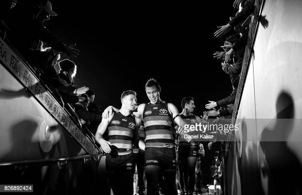 Rory Laird and Tom Lynch of the Crows walk from the field after the round 20 AFL match between the Adelaide Crows and the Port Adelaide Power at...