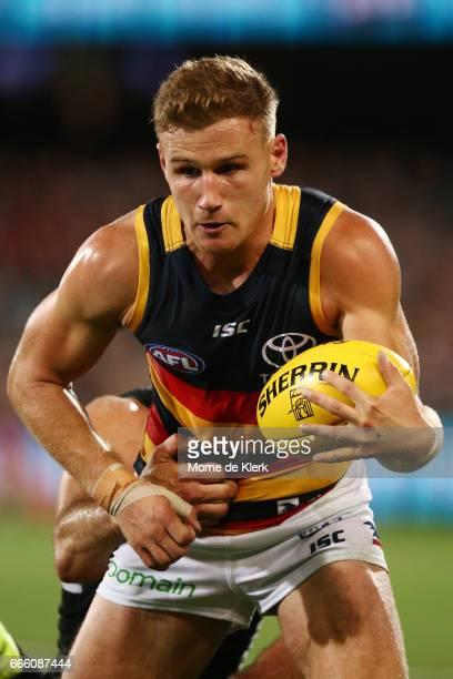 Rory Laird of the Crows breaks a tackle during the round three AFL match between the Port Adelaide Power and the Adelaide Crows at Adelaide Oval on...