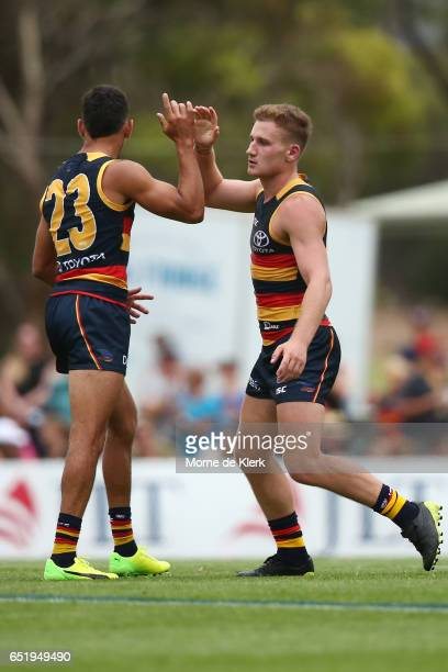 Rory Laird of the Crows celebrates after kicking a goal during the JLT Community Series AFL match between the Adelaide Crows and the Brisbane Lions...