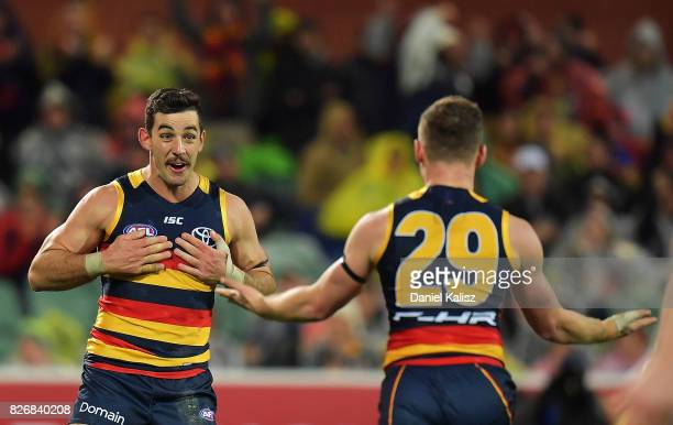 Rory Laird of the Crows celebrates with Taylor Walker of the Crows after kicking a goal during the round 20 AFL match between the Adelaide Crows and...