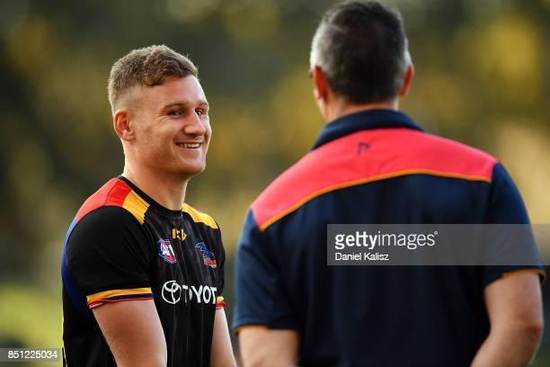 Rory Laird of the Crows chats with Adelaide Crows Assistant Coach Scott Camporeale prior to the First AFL Preliminary Final match between the...