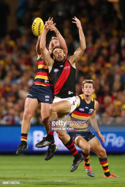 Rory Laird of the Crows competes with Jobe Watson of the Bombers during the round four AFL match between the Adelaide Crows and the Essendon Bombers...