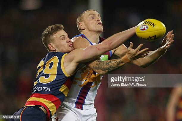 Rory Laird of the Crows competes with Mitch Robinson of the Lions during the 2016 AFL Round 20 match between the Adelaide Crows and the Brisbane...
