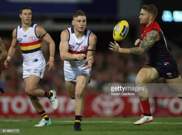 Rory Laird of the Crows handballs during the round 17 AFL match between the Melbourne Demons and the Adelaide Crows at TIO Stadium on July 15 2017 in...