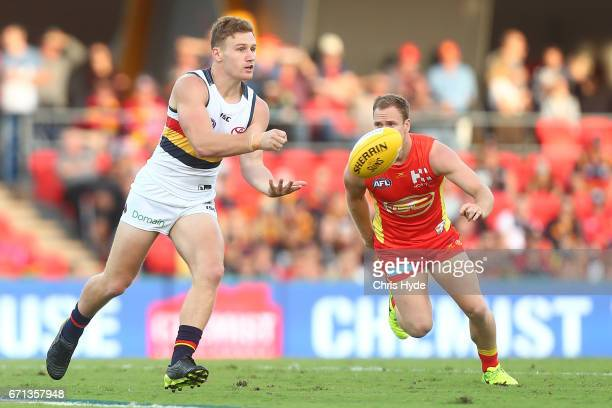 Rory Laird of the Crows handballs during the round five AFL match between the Gold Coast Suns and the Adelaide Crows at Metricon Stadium on April 22...