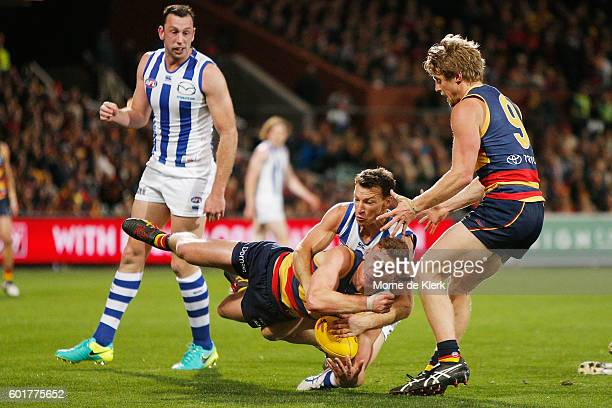 Rory Laird of the Crows is tackled by Brent Harvey of the Kangaroos during the AFL 1st Elimination Final match between the Adelaide Crows and the...
