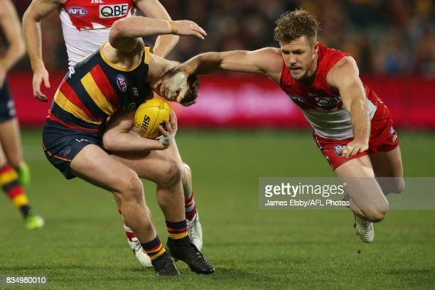 Rory Laird of the Crows is tackled by by Luke Parker of the Swans during the 2017 AFL round 22 match between the Adelaide Crows and the Sydney Swans...