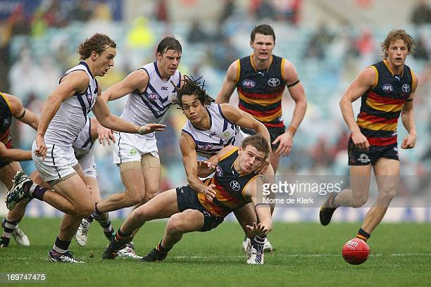 Rory Laird of the Crows is tackled by Tendai Mzungu of the Dockers during the round ten AFL match between the Adelaide Crows and the Fremantle...