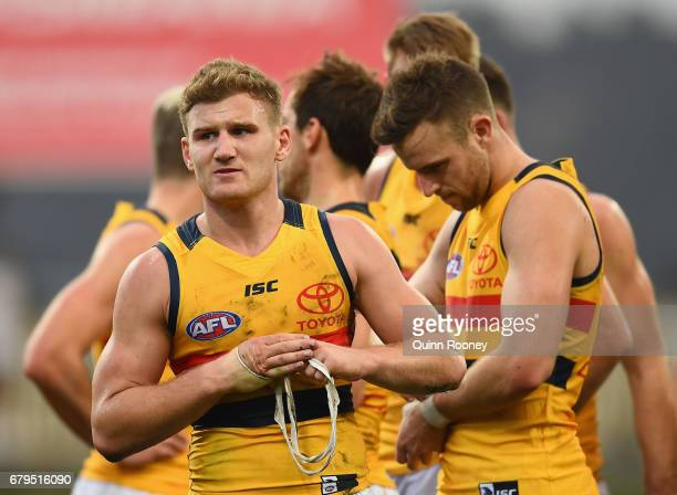 Rory Laird of the Crows look dejected after losing the round seven AFL match between the North Melbourne Kangaroos and the Adelaide Crows at...