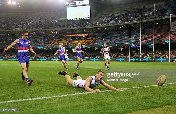 Rory Laird of the Crows reacts after fumbling the ball during the round four AFL match between the Western Bulldogs and the Adelaide Crows at Etihad...