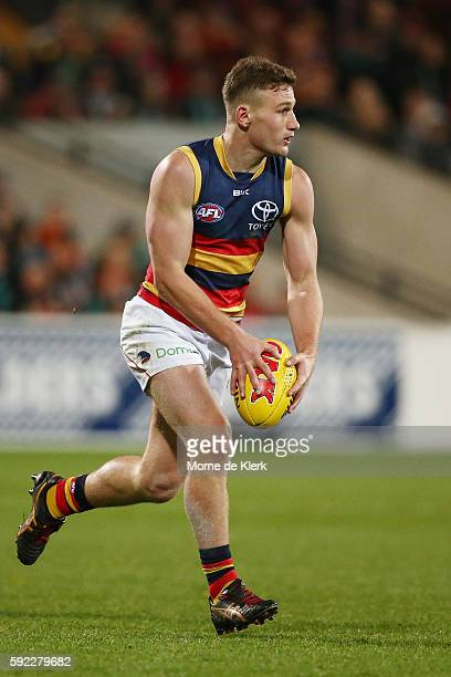 Rory Laird of the Crows runs with the ball during the round 22 AFL match between the Port Adelaide Power and the Adelaide Crows at Adelaide Oval on...