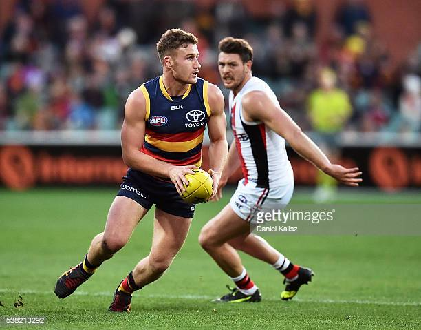 Rory Laird of the Crows tooks to pass the ball during the round 11 AFL match between the Adelaide Crows and the St Kilda Saints at Adelaide Oval on...
