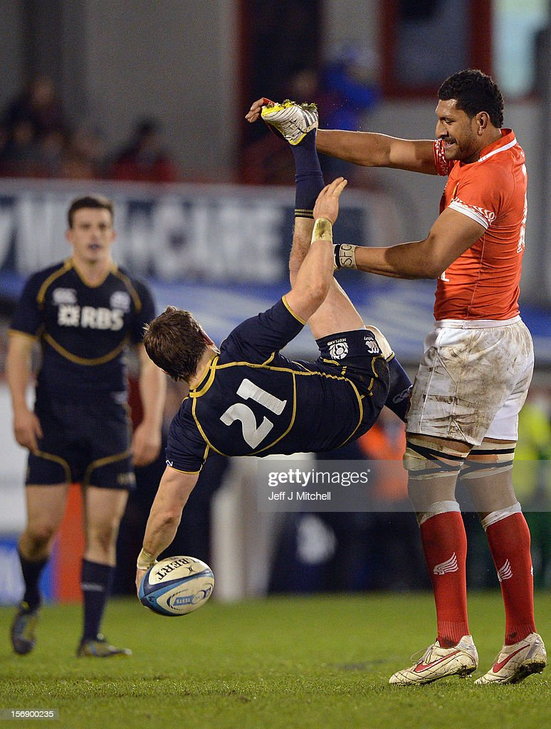 Rory Lawson of Scotland is foweld Sitiveni Mafi of Tonga during the international match between Scotland and Tonga at Pittodrie stadium on November 24, 2012 in Aberdeen,Scotland.