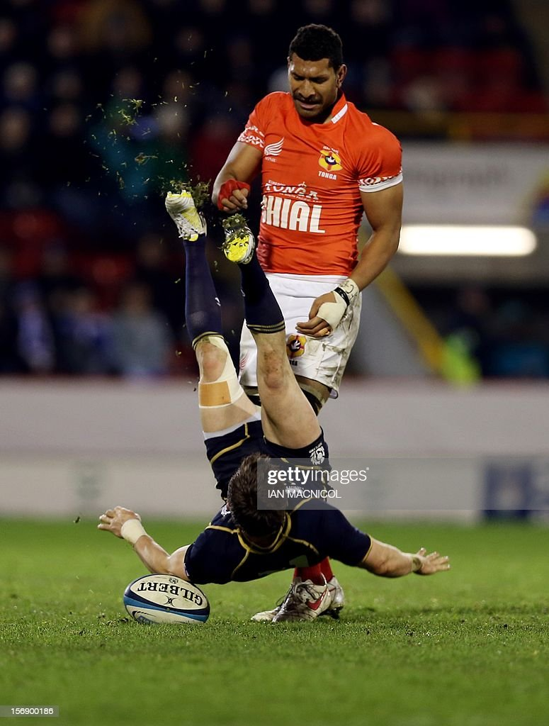 Rory Lawson (L) of Scotland is upended by Sione Timani of Tonga during the International rugby union test match between Scotland and Tonga at Pittodrie in Aberdeen on November 24, 2012. Tonga beat Scotland 21-15.