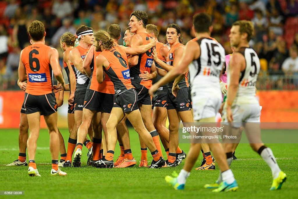 Rory Lobb of the Giants celebrates kicking a goal with team mates during the round six AFL match between the Greater Western Sydney Giants and the Hawthorn Hawks at Spotless Stadium on April 30, 2016 in Sydney, Australia.