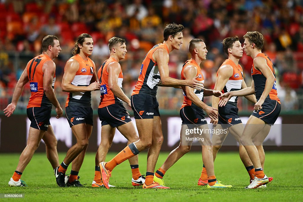Rory Lobb of the Giants celebrates with team mates after kicking a goal during the round six AFL match between the Greater Western Sydney Giants and the Hawthorn Hawks at Spotless Stadium on April 30, 2016 in Sydney, Australia.