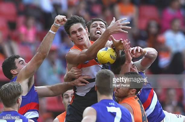 Rory Lobb of the Giants competes for the ball against Fletcher Roberts of the Bulldogs during the round nine AFL match between the Greater Western...