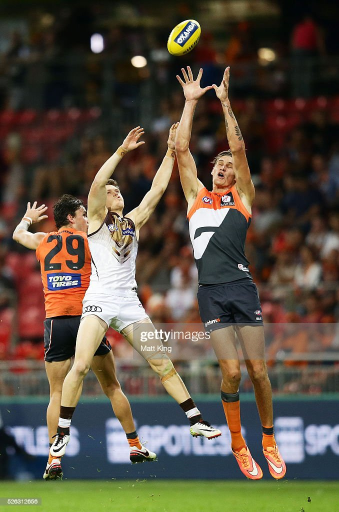 Rory Lobb of the Giants is challenged by Taylor Duryea of the Hawks during the round six AFL match between the Greater Western Sydney Giants and the Hawthorn Hawks at Spotless Stadium on April 30, 2016 in Sydney, Australia.