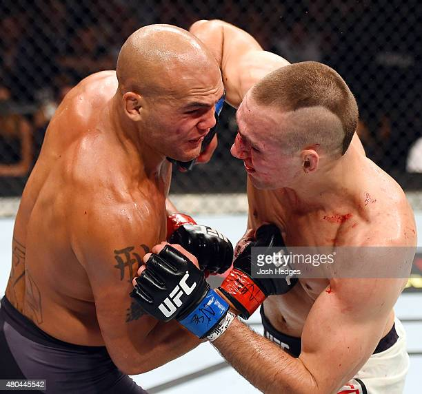 Rory MacDonald elbows Rory MacDonald in their UFC welterweight title fight during the UFC 189 event inside MGM Grand Garden Arena on July 11 2015 in...