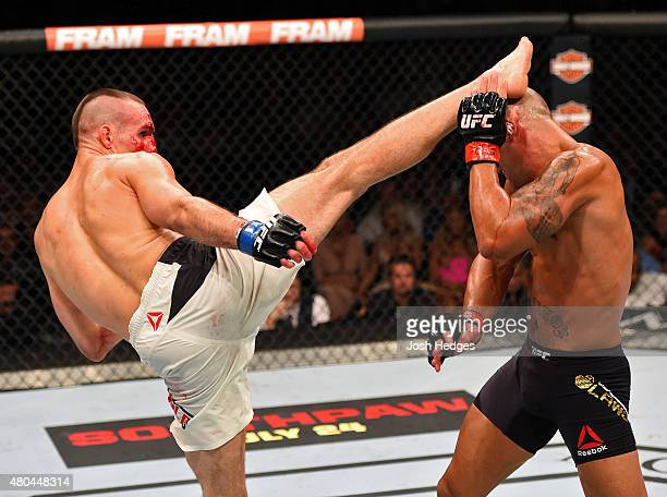 Rory MacDonald kicks Robbie Lawler in their UFC welterweight title fight during the UFC 189 event inside MGM Grand Garden Arena on July 11 2015 in...