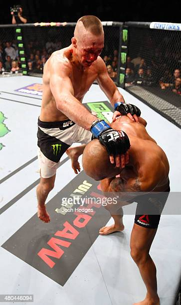 Rory MacDonald knees Robbie Lawler in their UFC welterweight title fight during the UFC 189 event inside MGM Grand Garden Arena on July 11 2015 in...