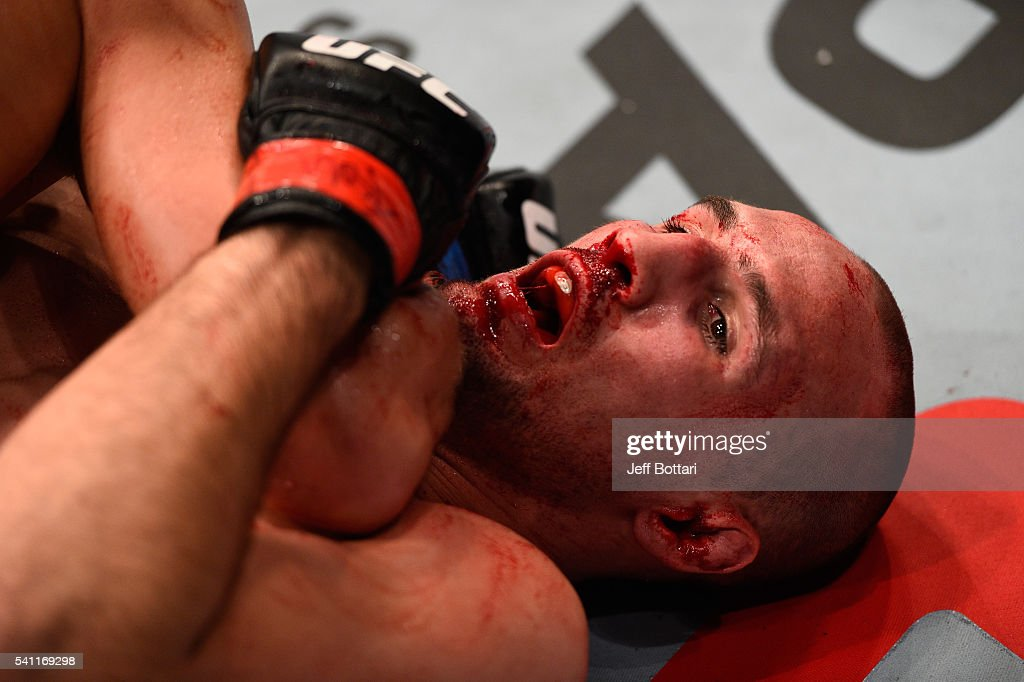 Rory MacDonald of Canada is take down by Stephen Thompson of the United States in their welterweight bout during the UFC Fight Night event inside the TD Place Arena on June 18, 2016 in Ottawa, Ontario, Canada.