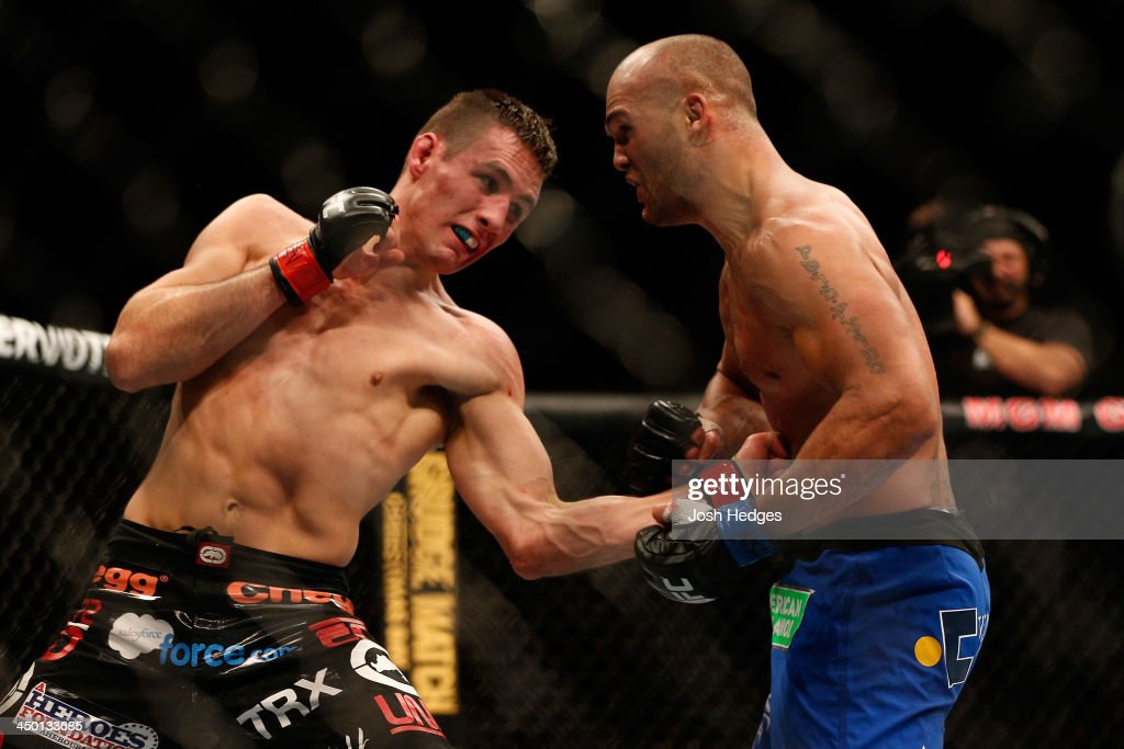 Rory MacDonald punches Robbie Lawler in their welterweight bout during the UFC 167 event inside the MGM Grand Garden Arena on November 16, 2013 in Las Vegas, Nevada.