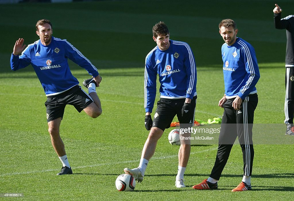 Rory McArdle (L), Kyle Lafferty (2nd L) and Gareth McAuley (R) of Northern Ireland await instruction as the international football squad train at Windsor Park on October 7, 2015 in Belfast, Northern Ireland. Northern Ireland host Greece in a Euro 2016 Group F game at Windsor Park on Thursday evening.