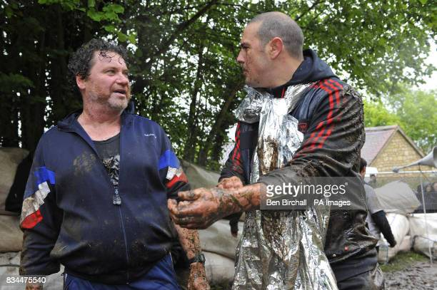 Rory Mcgrath and Patrick McGuinness after taking part in the annual cheese rolling event at Coopers Hill Gloucestershire