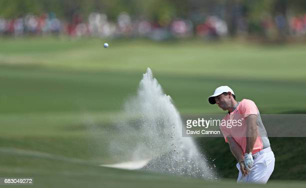 Rory McIlory of Northern Ireland plays his third shot on the par 5 ninth hole during the final round of the THE PLAYERS Championship on the Stadium...