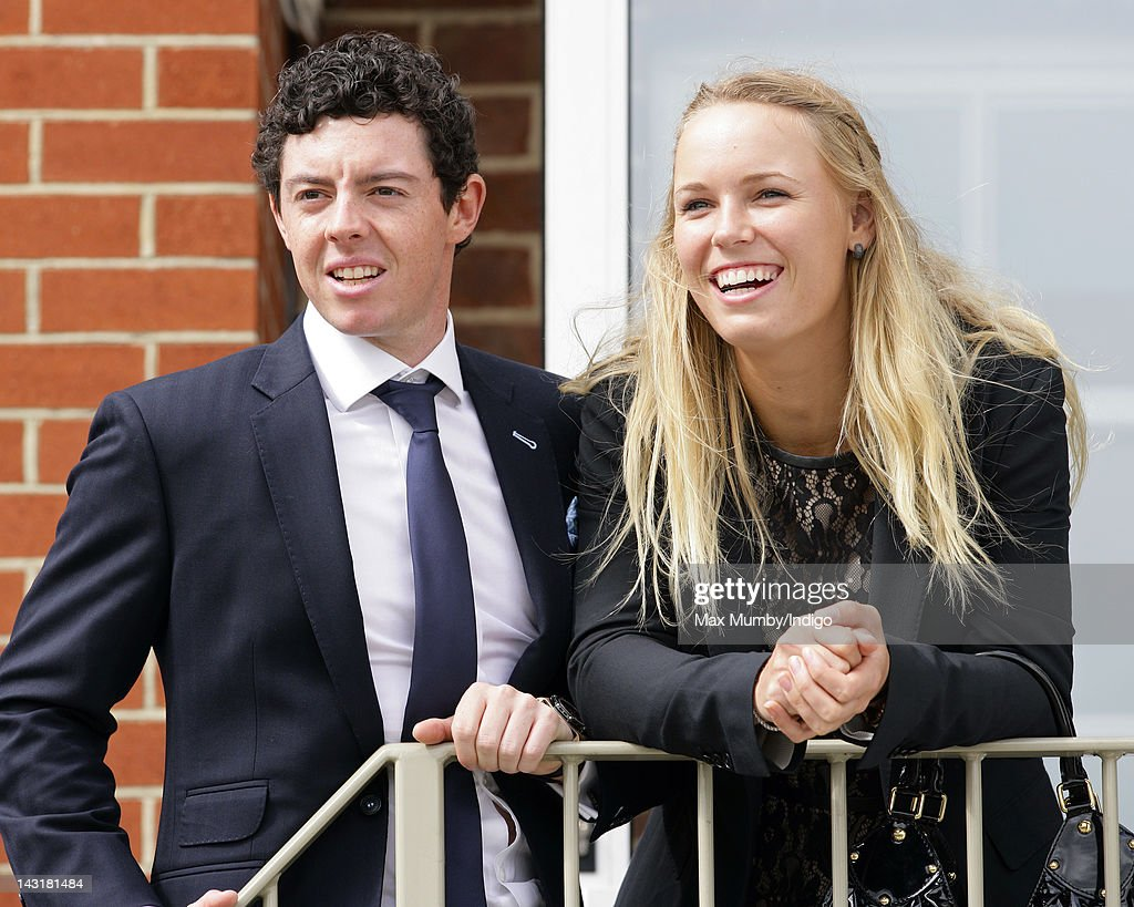<a gi-track='captionPersonalityLinkClicked' href=/galleries/search?phrase=Rory+McIlroy&family=editorial&specificpeople=783109 ng-click='$event.stopPropagation()'>Rory McIlroy</a> and <a gi-track='captionPersonalityLinkClicked' href=/galleries/search?phrase=Caroline+Wozniacki&family=editorial&specificpeople=740679 ng-click='$event.stopPropagation()'>Caroline Wozniacki</a> attend the Dubai Duty Free Race Day at Newbury Racecourse on April 20, 2012 in Newbury, England.