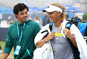 Rory McIlroy and girlfriend Caroline Wozniacki leave the practice court during day six of the AEGON International tennis tournament at Devonshire...