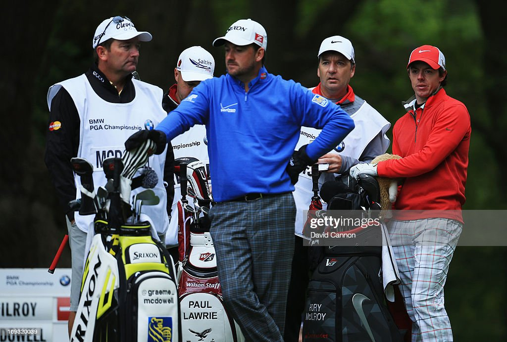 Rory McIlroy and Graeme McDowell of Northern Ireland wait on a tee during the first round of the BMW PGA Championship on the West Course at Wentworth on May 23, 2013 in Virginia Water, England.