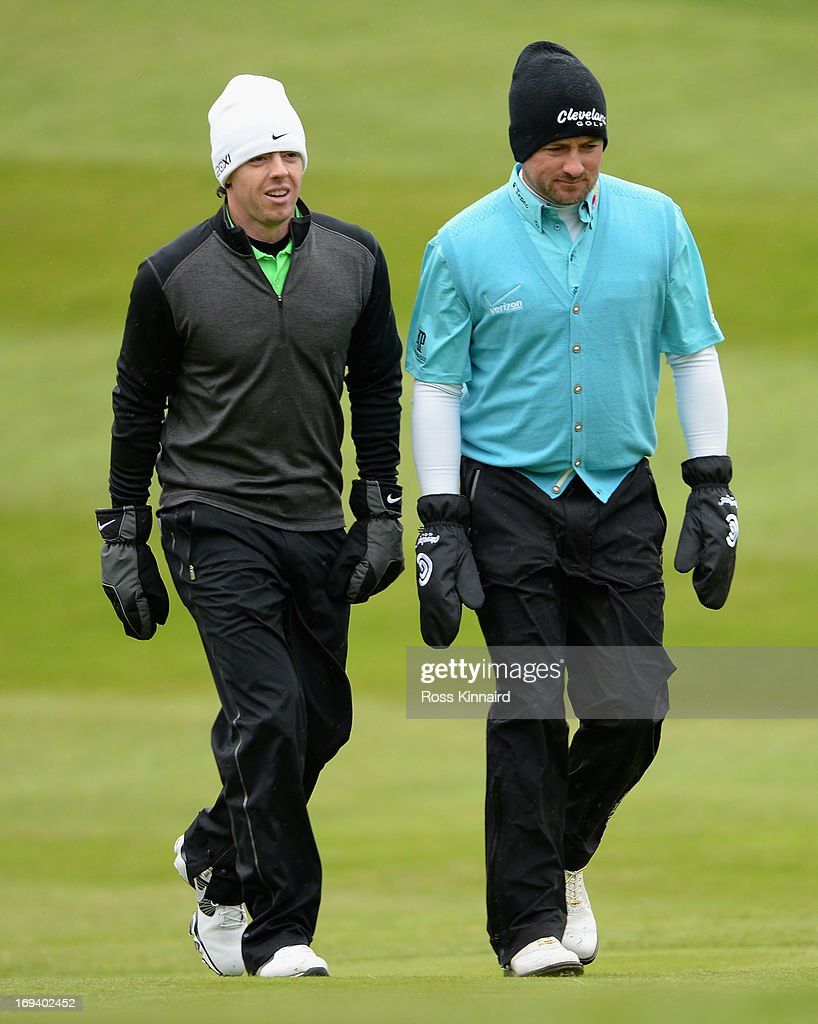 <a gi-track='captionPersonalityLinkClicked' href=/galleries/search?phrase=Rory+McIlroy&family=editorial&specificpeople=783109 ng-click='$event.stopPropagation()'>Rory McIlroy</a> and <a gi-track='captionPersonalityLinkClicked' href=/galleries/search?phrase=Graeme+McDowell&family=editorial&specificpeople=196520 ng-click='$event.stopPropagation()'>Graeme McDowell</a> of Northern Ireland walk up the first fairway during the second round of the BMW PGA Championship on the West Course at Wentworth on May 24, 2013 in Virginia Water, England.