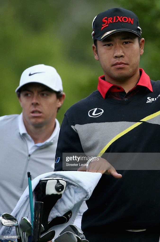 Rory McIlroy and Hideki Matsuyama wait to hit during the first round of the 2016 Wells Fargo Championship at Quail Hollow Club on May 5, 2016 in Charlotte, North Carolina.