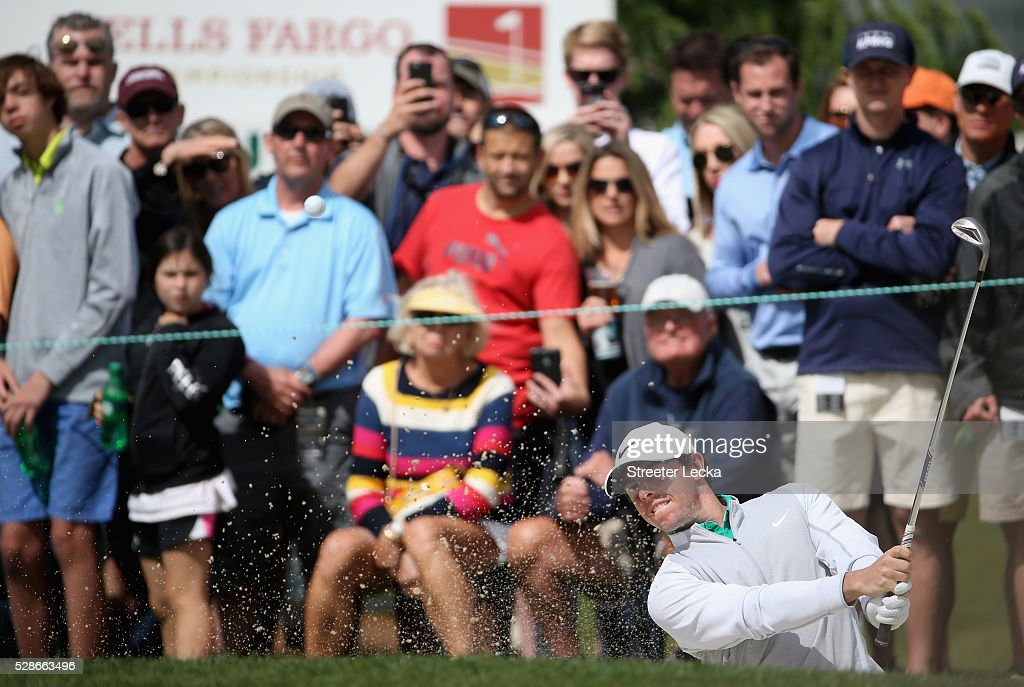 Rory McIlroy hits a shot from the sand on the 10th hole during the second round of the 2016 Wells Fargo Championship at Quail Hollow Club on May 6, 2016 in Charlotte, North Carolina.