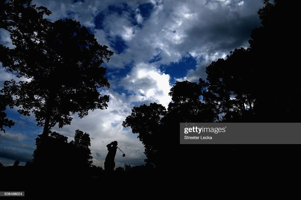 Rory McIlroy hits a tee shot on the 14th hole during the first round of the 2016 Wells Fargo Championship at Quail Hollow Club on May 5, 2016 in Charlotte, North Carolina.