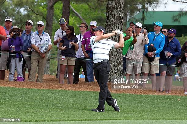 Rory McIlroy hits from the fairway on the 15th hole during the practice round for the 2015 Masters Tournament at the Augusta National Golf Club in...