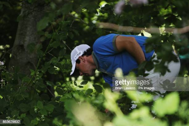 Rory McIlroy looks at his ball after going in the rough on the 4th hole during day two of the 2014 Irish Open at Fota Island Resort County Cork...