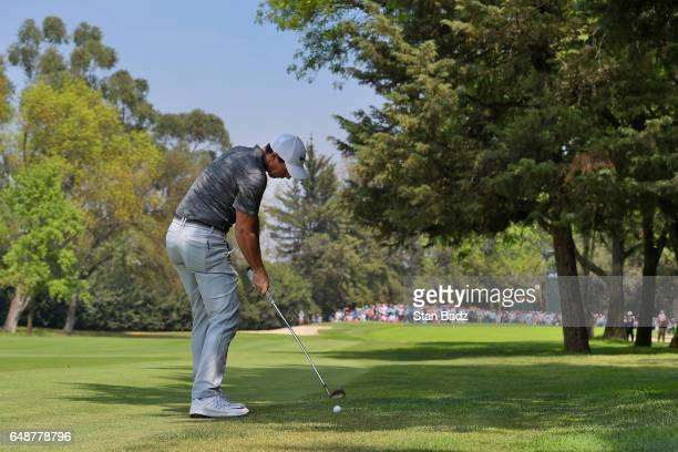 Rory McIlroy Northern Ireland hits a shot on the fourth hole during the final round of the World Golf ChampionshipsMexico Championship at Club de...