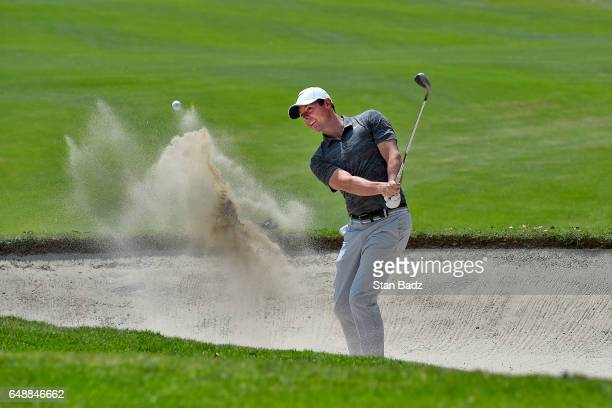 Rory McIlroy Northern Ireland plays a bunker shot on the first hole during the final round of the World Golf ChampionshipsMexico Championship at Club...