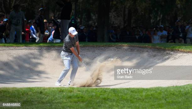 Rory McIlroy Northern Ireland plays a bunker shot on the third hole during the final round of the World Golf ChampionshipsMexico Championship at Club...
