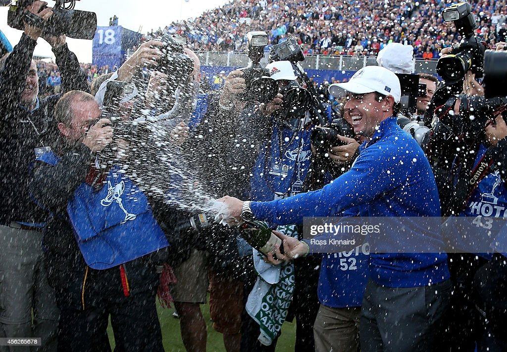 Rory McIlroy of Europe celebrates winning the Ryder Cup as he sprays champagne after the Singles Matches of the 2014 Ryder Cup on the PGA Centenary...