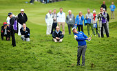 Rory McIlroy of Europe plays his approach to the 14th hole during the Singles Matches of the 2014 Ryder Cup on the PGA Centenary course at the...