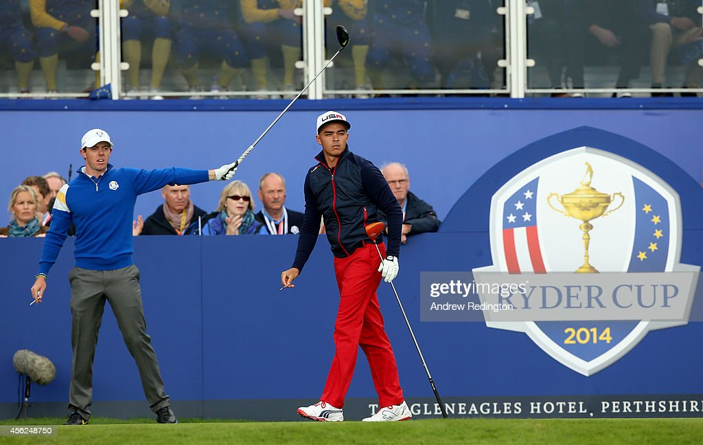 Rory McIlroy of Europe points in the direction of his tee shot with Rickie Fowler of the United States on the 1st hole during the Singles Matches of...
